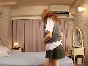 Japanese schoolgirl undresses uniform and widens