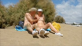 Stripped breasts, twat and 10-Pounder on a beach