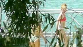 Bikini babes enjoy the sun...