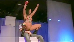 Stripper gives blowjobs to two lucky stage...