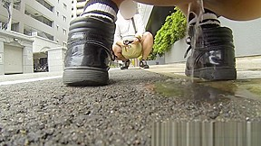 Teenage asian redhead filmed while peeing street...