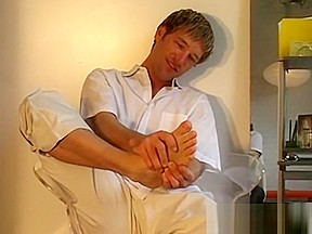 Wriggler takes socks off when masturbating solo...