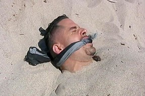 Marcus buried at the beach...
