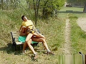 Horny milf in a public park...