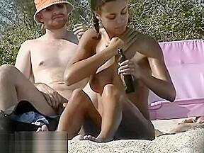 Dark haired nudist spied pissing beachvoyeur voyeur...
