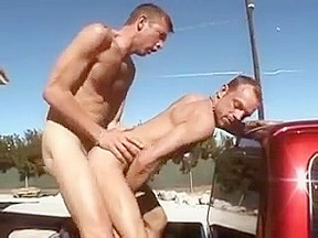 Two hunks went to the outdoors to have...