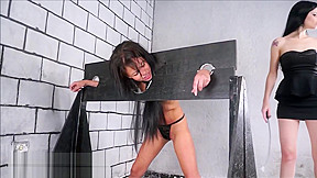Wooden stocks whipping of lesbian brazilian bdsm babe...