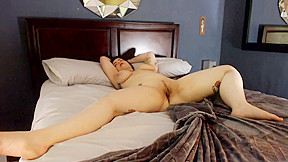 Busty chubby chick rolls around sheets...