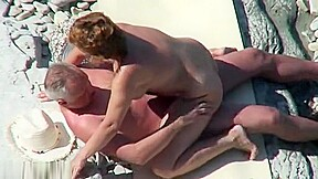 Mature nudist couple caught...