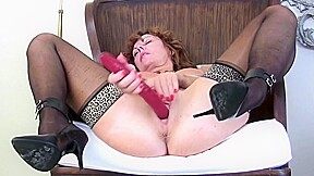 Redhead strips with herself for you...