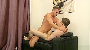 Muscular stud feeds the boy his large hard...