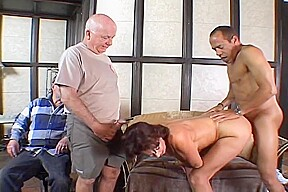 Men watch one sexy latina ride a huge...