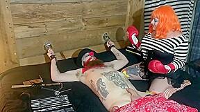 Sadistic femdom kidnaps innocent clown ball torture...