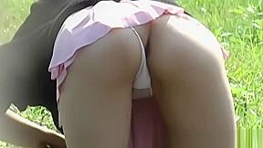Asian secretly filmed upskirt outdoors...