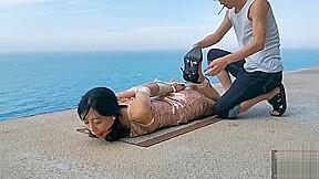 Public bondage seaside...