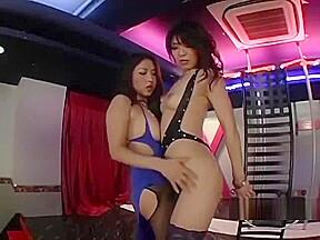 2 asian strippers patting sucking nipples the nightclub...