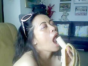 THAI OLDER LADY SHOWING HER LARGE LOVE BUBBLES AND ENGULFING BANANA-