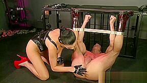 Horny mistress slides glass dildo up male subs...