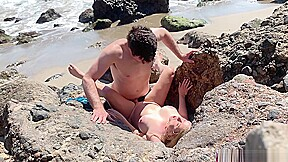 Voluptuous blonde sunbathing nude beach fucks passer by...