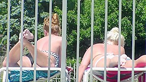 1 of 3 candid tanning pool selfie blonde...