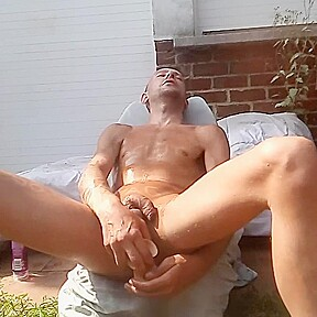 Amateur masturbating full nude outdoors backyard with a...