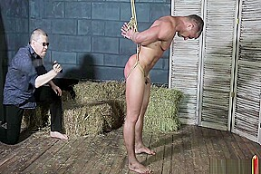 Whipped and nipples tortured naked bodybuilder...