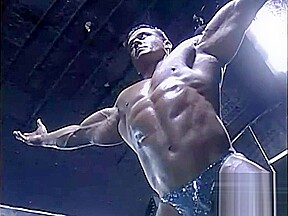 Big muscular hunk posing his perfectly proportioned body...