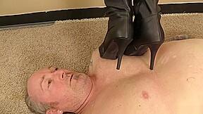 A human rug with black platform boots...