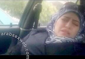 Fat Arab Slut masturbates in a car