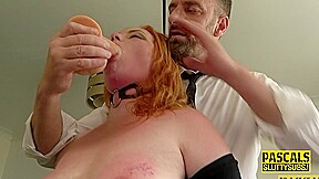 Plump submissive redhead throats cock