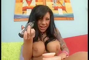 Masturbates sex toy in porn movie...