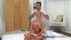 Natural big tits are oiled and massaged as foreplay to a fuck