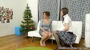 Svetlana and her sexy young female friend sit discussing sexy things in her home.