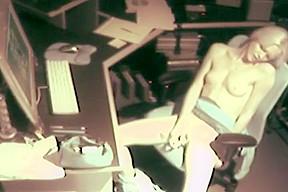 Cam catches petite blonde masterbating at work...