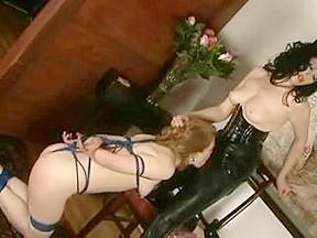 Serf hotty licks her latex dominatrix bitch...