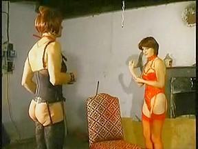 Deep fisting of a submissive cross dressing slut
