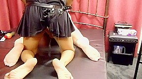 Hot mistress in latex fucks her submissive male