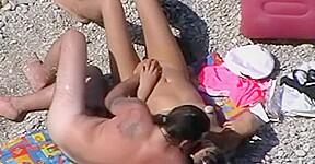 Cute couple spied on beach...
