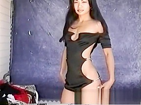 Janice tries on different clothes while posing and...