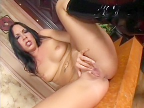 Striking brunette julie fingers her pussy while hole...