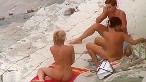 Three women naked beach...