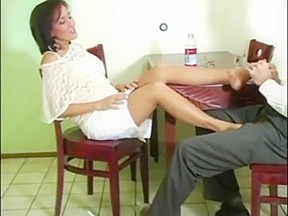 Roni gives her man a nylon footsie over...