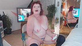 V90 redhead milf in reading erotica and masturbating...