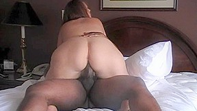 Busty white BBW riding on a big black dick on the bed
