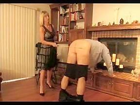 Blonde mistress enjoys spanking her thrall