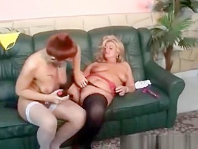 Lesbian Grannies Having Fun On The Green Sofa