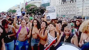 Argentinian protesting topless...