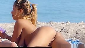 Horny nudist beach lesbians fingering pussies...