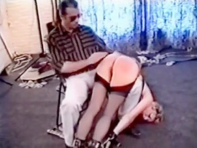 The slave gets a painful spanking from her...