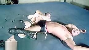 Wrestlers in ring...